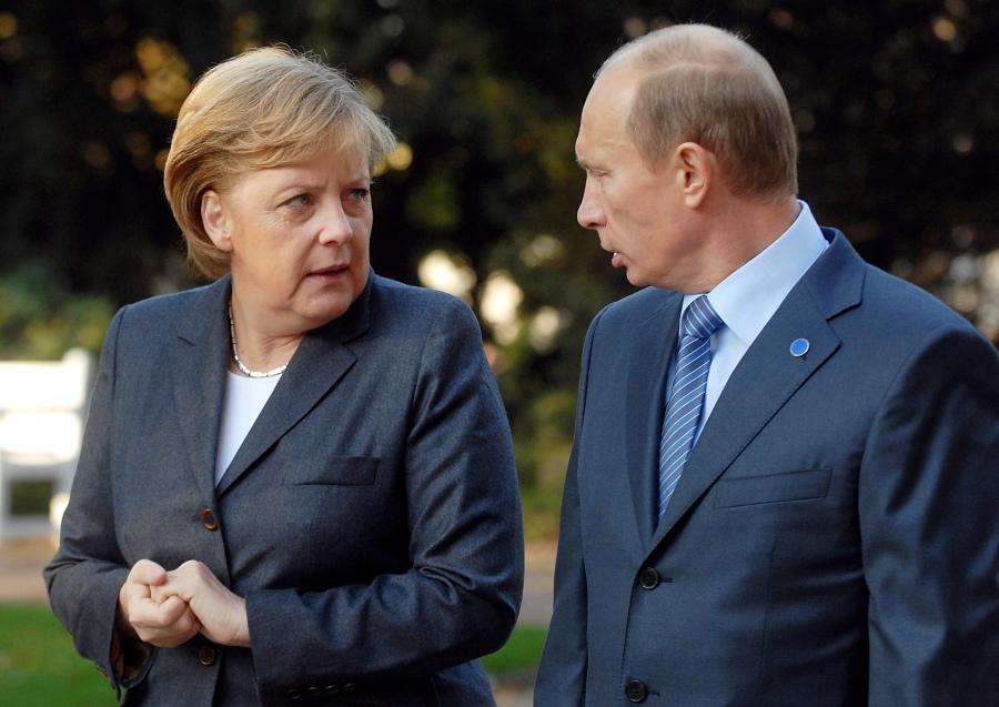 Russia's President Putin talks to German Chancellor Merkel at the Kurhaus resort garden in Wiesbaden