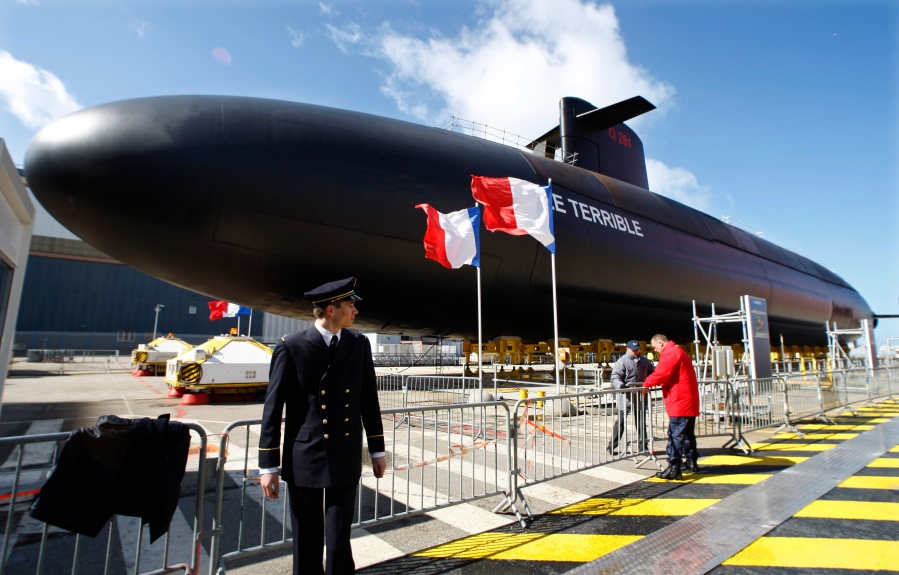 "A French Navy officer looks at  ""Le Terrible"" nuclear submarine in Cherbourg, western France"