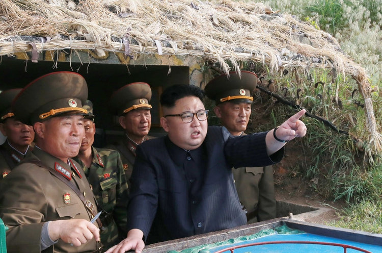2017.09.17 North Korean leader Kim Jong Un, center, inspecting the defence detachment on Jangjae Islet and the Hero Defence Detachment on Mu Islet STR-AFP-Getty images LNJCEN2X2RFDPIOSZ4