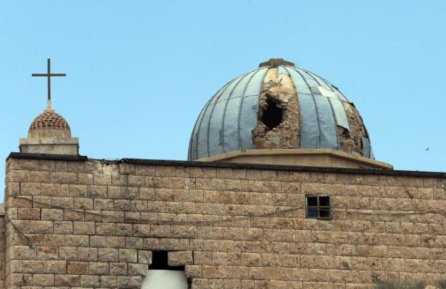 SYRIE 718480-une-eglise-endommagee-dans-une-ville-a-majorite-chretienne-de-syrie-a-maalula-le-14-mai-2014