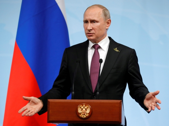 FILE PHOTO: Russian President Vladimir Putin speaks during a news conference after the G20 summit in Hamburg