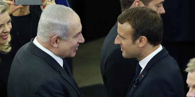 Israeli Prime Minister Netanyahu speaks to French President Macron during a memorial ceremony in honour of late former German Chancellor Kohl, at the European Parliament in Strasbourg