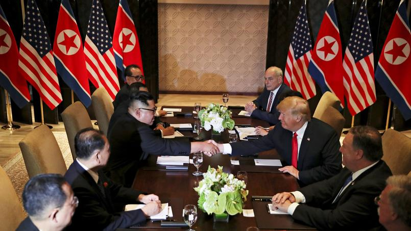 U.S. President Donald Trump shakes hands with North Korea's leader Kim Jong Un before their expanded bilateral meeting in Singapore