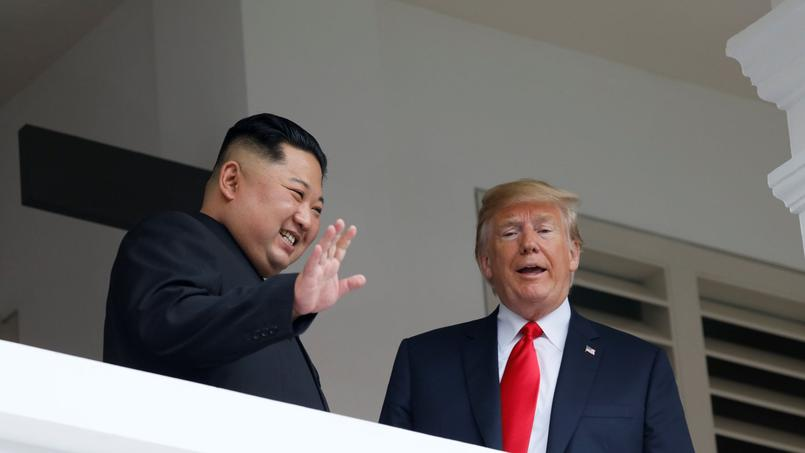 U.S. President Donald Trump talks with North Korean leader Kim Jong Un at the Capella Hotel on Sentosa island in Singapore