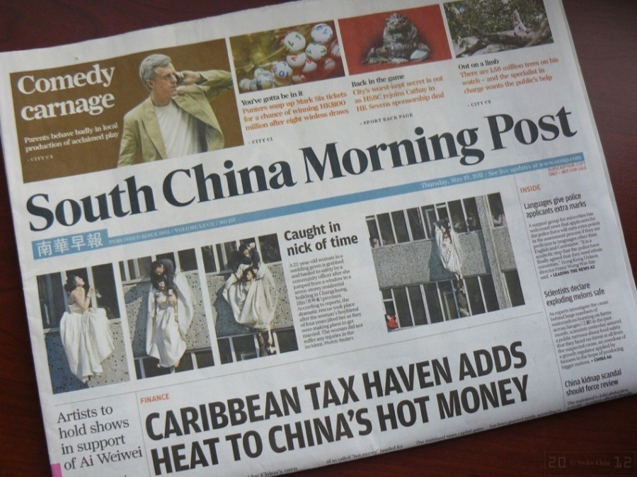 journal CONFIRMED-Alibaba-buys-South-China-Morning-Post