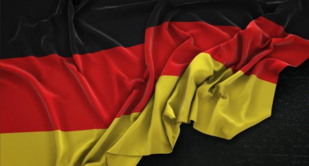ALLEMAGNE drapeau-de-l-39-allemagne-enroule-sur-fond-sombre-3d-render_1379-666
