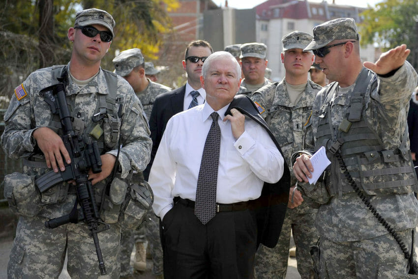 USA Robert-Gates-with-troops-850x567Then-Secretary of Defense Robert Gates during a 2008 visit to Kosovo with U.S. Army troops on foot patrol in the town of Gnjilane. (The U.S. Army- CC