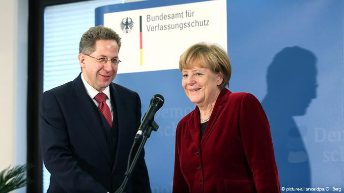 ALLEMAGNE German Chancellor Angela Merkel (R) and Hans-Georg Maassen, president of Bundesamt fuer Verfassungsschutz (BfV), the federal domestic 45477157_303
