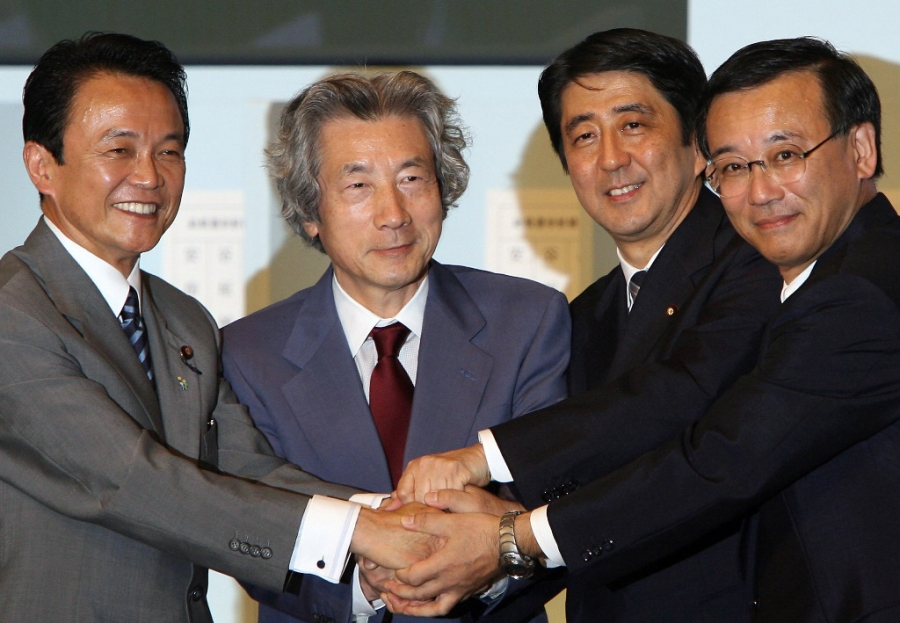 Japan's Shinzo Abe (2nd R), the newly elected as the president o