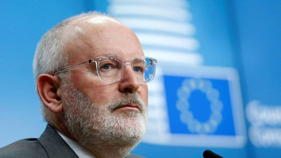 FILE PHOTO: European Commission First Vice-President Frans Timmermans addresses a news conference during a European Union's General Affairs Council in Brussels