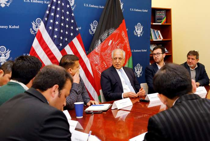 U.S. special envoy for peace in Afghanistan, Zalmay Khalilzad, (C) speaks during a roundtable discussion with Afghan media at the U.S Embassy in Kabul, Afghanistan