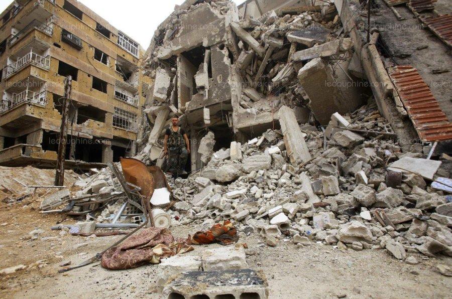 douma-etait-le-dernier-bastion-rebelle-dans-la-ghouta-orientale-quelques-jours-apres-l-attaque-chimique-presumee-les-opposants-au-regime-ont-accepte-de-quitter-les-lieux-photo-youssef-karwashan-afp-1523635036