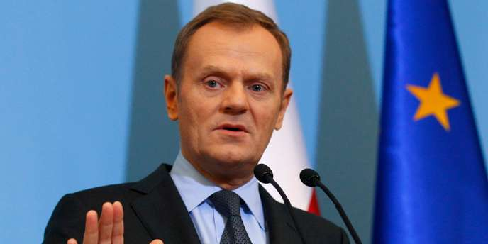 Poland's Prime Minister Tusk gestures as he announces members of new government during news conference one day before the inauguration of the new cabinet at Prime Minister Chancellery in Warsaw