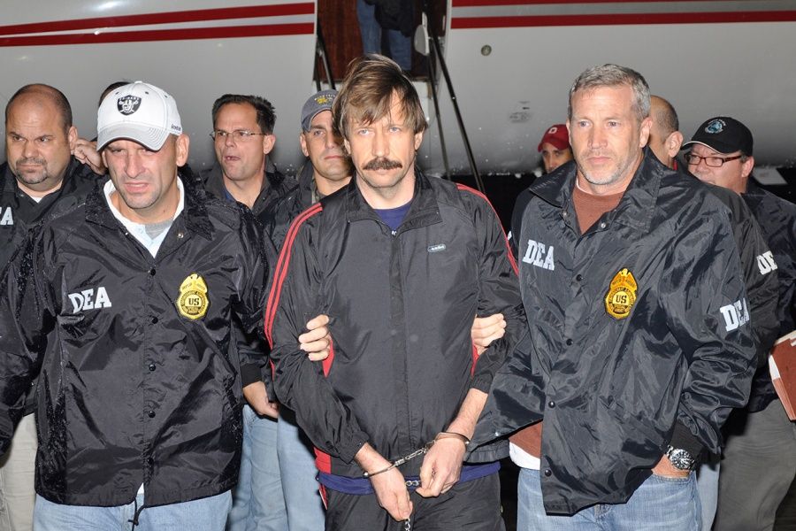 File handout image shows suspected Russian arms dealer Bout is escorted by DEA officers after arriving in New York