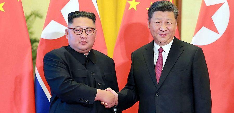 CHINE COREE NORD XI JINPING and KIM JONG Au menu le programme nucléaire nord-coréen, qui vaut au régime nord-coréen d'être mis au ban des nations