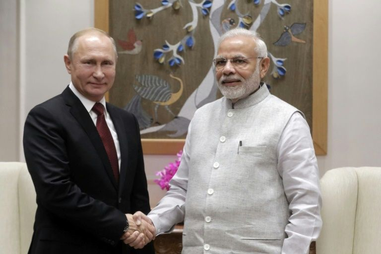 Russian President Vladimir Putin is expected to tie up arms deals worth billions of dollars with Indian Prime Minister Narendra Modiafp-a45659310fd1c8a26e364ff8584cbf829e13f339