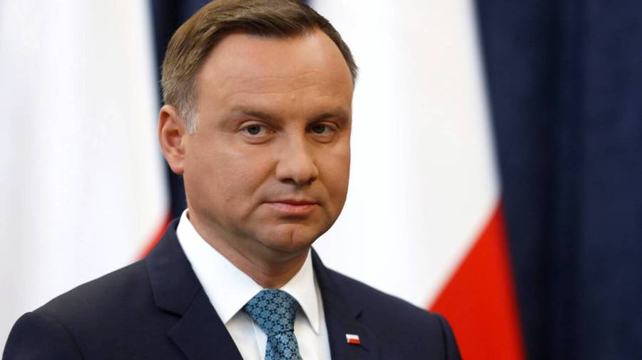 FILE PHOTO:Poland's President Duda looks on during his media announcement about Supreme Court legislation in Warsaw