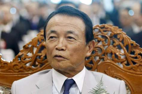 Japan's Finance Minister Taro Aso as he attends the opening ceremony of the Thilawa Special Economic Zone (SEZ) at Thanlyin township outside Yangon September 23, 2015. Thilawa SEZ, one of the major economic projects started by president Thein Sein with the help of Japanese funding, is a $1.5 billion manufacturing complex designed to lure investment and help the impoverished country compete in the global marketplace. REUTERS/Soe Zeya Tun