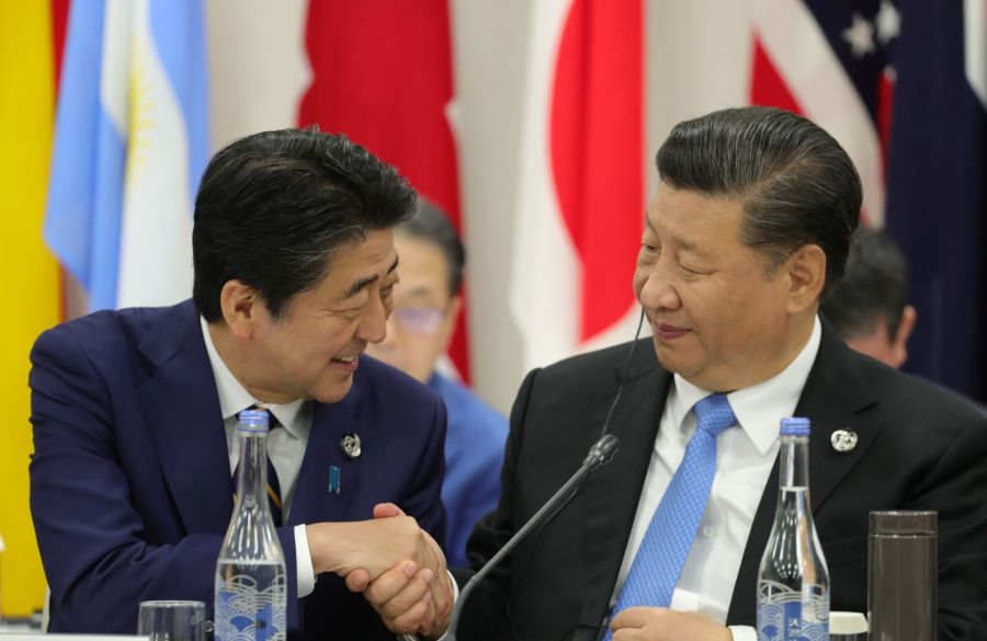 Japan's Prime Minister Shinzo Abe and China's President Xi Jinping attend the G20 summit in Osaka