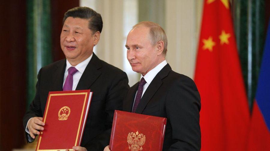 RUSSIE CHINE le-president-russe-vladimir-poutine-d-et-son-homologue-chinois-xi-jinping-le-5-juin-2019-a-saint-petersbourg_6187440