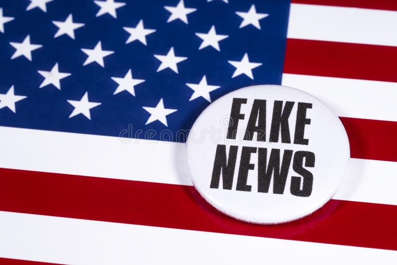 fake-news-usa-pin-badge-pictured-over-flag-united-states-america-164641772