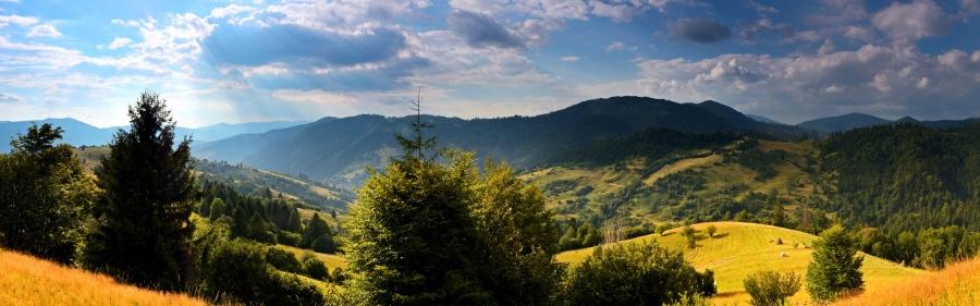 Ukraine-nature-landscape-trees-grass-mountains-clouds-sun_3840x1200