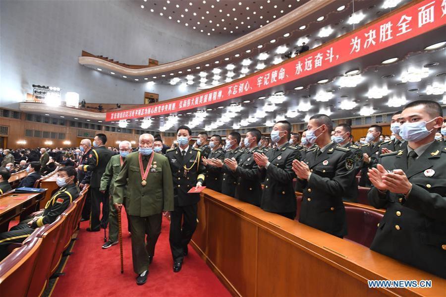 BEIJING, 23 octobre (Xinhua) -- Des vétérans des Volontaires du peuple chinois (VPC) marquant le 70e anniversaire de l'entrée des VPC en Corée (RPDC)