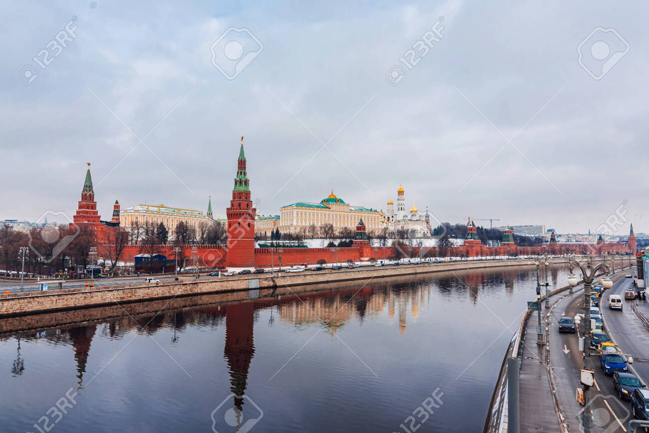 MOSCOW, RUSSIA - FEBRUARY 01, 2020: Urban landscape with views of the Kremlin wall and the Moscow river. The Grand Kremlin Palace, the Archangel Cathedral