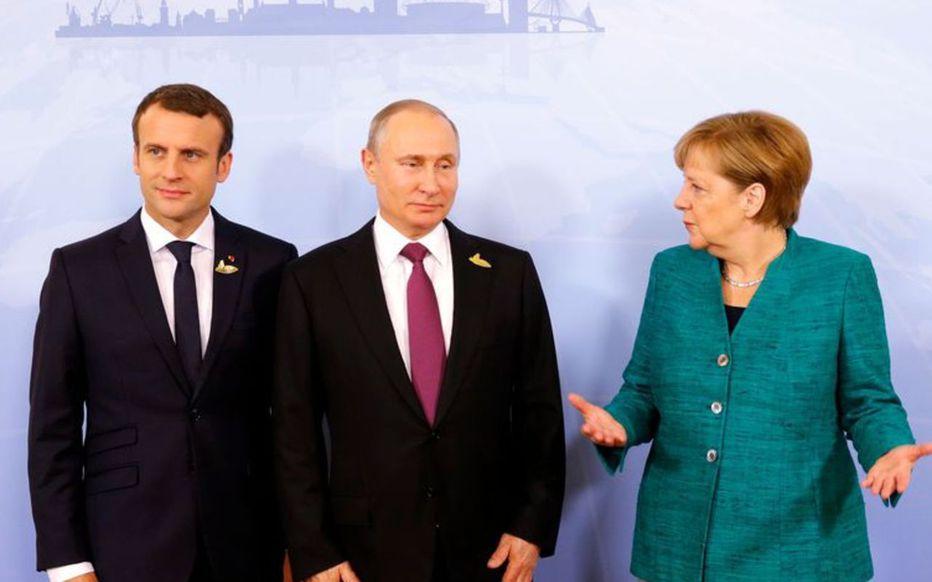 Emmanuel Macron, Vladimir Poutine et Angela Merkel se retrouveront à Paris avec le nouveau président ukrainien Volodymyr Zelensky (Illustration). AFP Philippe WOJAZER.