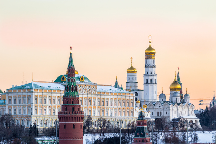 Moscow Kremlin closeup at frosty winter morning and golden sky.
