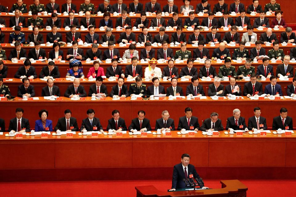 1065447-chinese-president-xi-jinping-delivers-his-speech-during-the-opening-session-of-the-19th-national-con