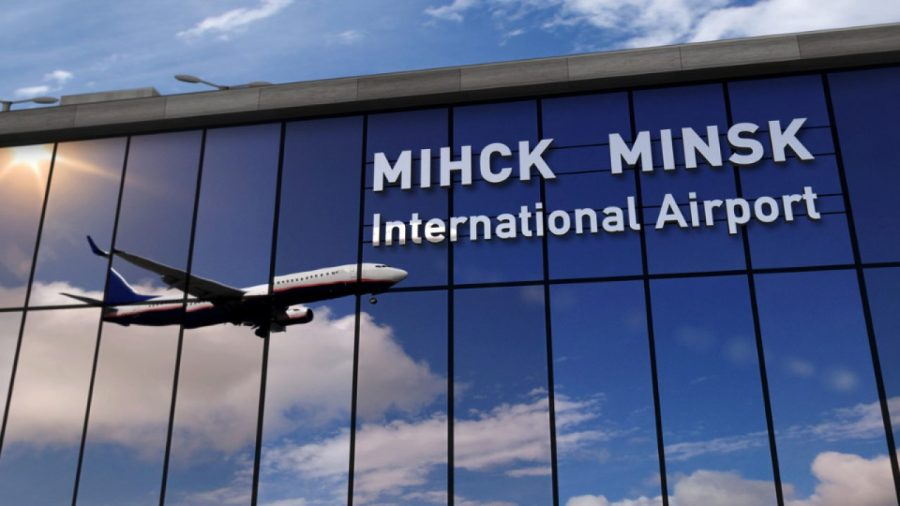 airplane-landing-at-minsk-mirrored-in-terminal-picture-id1215870593-1280x720